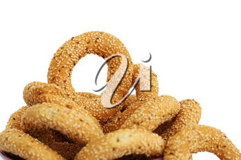 Round rusks with sesame seeads isolated on white background.