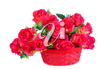 Red fabric roses in wicker basket isolated on white background.