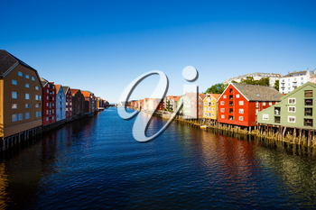 Colorful old houses at the Nidelva river embankment in Trondheim, Norway.
