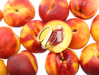 A heap of peaches with cutting of one, on white background. Isolated
