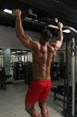 Young Man Athlete Doing Pull Ups - Chin-Ups In The Gym