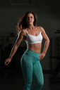 Portrait Of A Physically Fit Woman Showing Her Well Trained Body - Muscular Athletic Bodybuilder Fitness Model Posing After Exercises