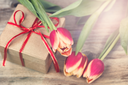 Romantic flowers and gift with light effect.