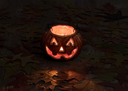 Pumpkin decoration glowing in darkness on rustic wood with autumn leaves