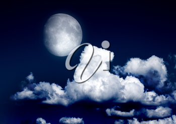The moon in the night sky in clouds Elements of this image furnished by NASA