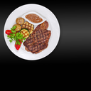 Grilled steak, baked potatoes and vegetables on white plate on black background.