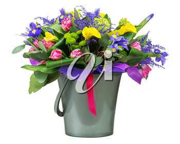 Beautiful bouquet of tulips, iris, alstroemeria, lilies and other flowers in vase isolated on white background.
