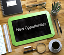 New Opportunities Handwritten on Green Chalkboard. Top View Composition with Small Chalkboard on Working Table with Office Supplies Around. Small Chalkboard with New Opportunities. 3d Rendering.