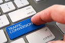 Business Concept - Male Finger Pointing Blue Traffic Conversion Button on Modern Laptop Keyboard. 3D Illustration.