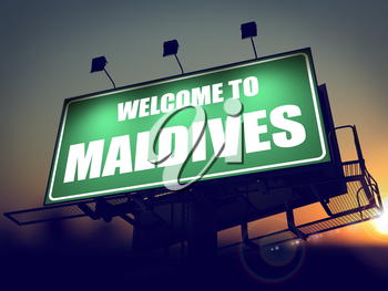 Welcome to Maldives - Green Billboard on the Rising Sun Background.