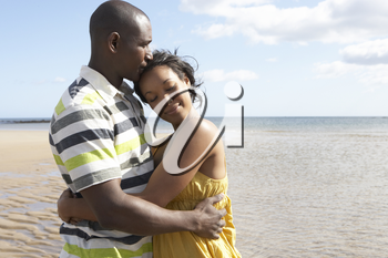 Romantic Young Couple Embracing On Beach