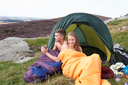 Young Couple On Camping Trip In Countryside