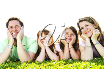 Portrait of happy family of four laying resting head on hands