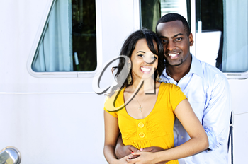 Portrait of young romantic couple hugging in front of yacht