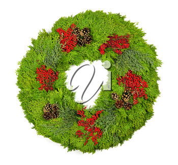 Green Christmas wreath with pine cones and berries isolated on white
