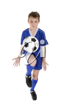 A boy using a soccer ball skills practice.  Ball has some motion.  White background.