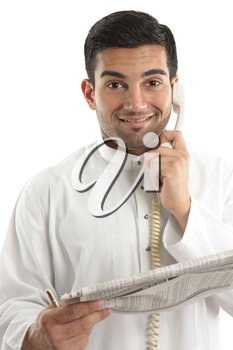 Happy businessman, accountant, banker, stockbroker, etc on the phone and holding a newspaper at the finance section.