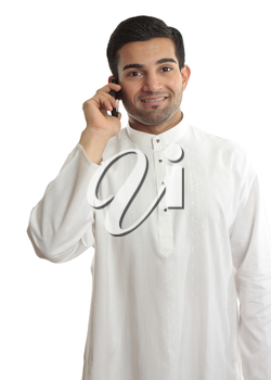 Smiling ethnic business man using a mobile phone and in traditional ethnic robe - Kurta - fastened with ruby buttons. The name Kurta is a borrowing from Urdu and Hindi,and originally from Persian (lit