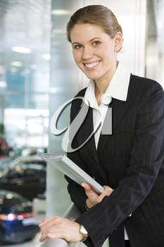 Photo of smart business lady touching balcony railing and looking at camera with smile