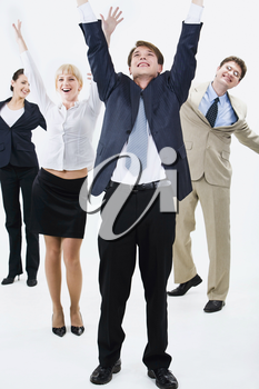 Happy business team are standing and raising hands upwards