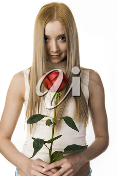 Portrait of elegant long-haired lady with beautiful rose looking at camera