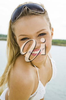 Portrait of beautiful blonde on background of blue sea