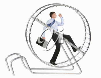 Photo of running man in metal wheel over white background