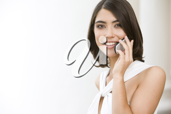 Photo of confident woman calling by telephone outdoor