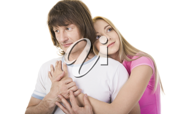 Portrait of attractive young girl embracing her boyfriend over white background