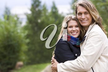 Portrait of affectionate couple embracing outdoors