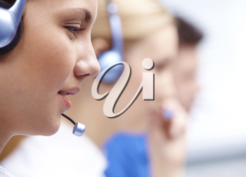 Close-up of customers representative with headset in line during work