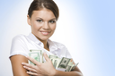 Portrait of young woman holding money on a white background