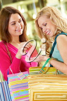 A young woman giving a little present to her girlfriend
