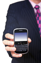 Man holding a mobile phone organiser towards camera, screen has a clipping path to add your own message or image. The device has been significantly altered from the original product.