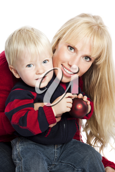 A caucasian mother and son holding a christmas ornament