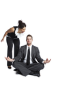 A shot of a black  businesswoman yelling at a meditating caucasian businessman