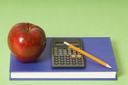 math class with red apple and yellow pencil