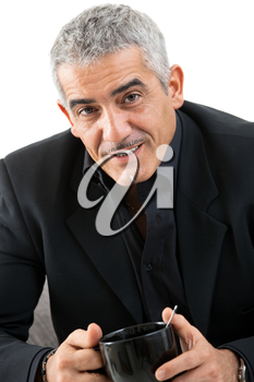 Happy mature man drinking tea, smiling, isolated on white background.