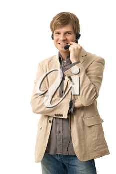 Casual young man talking on headset, holding microphone, smiling. Isolated on white.