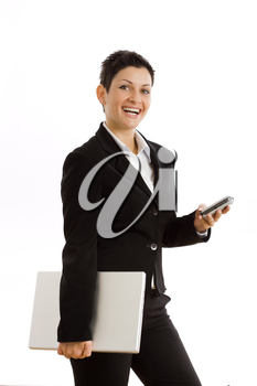 Happy businesswoman with mobile phone and laptop computer, smiling, isolated on white.