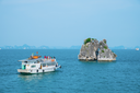 Boat and island in Halong Bay, Vietnam, Southeast Asia