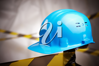 blue helmet and protective tape on site, selective focus on center