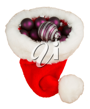 Santas hat filled with Christmas purple balls