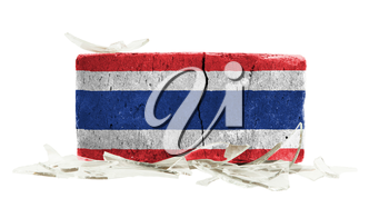 Brick with broken glass, violence concept, flag of Thailand