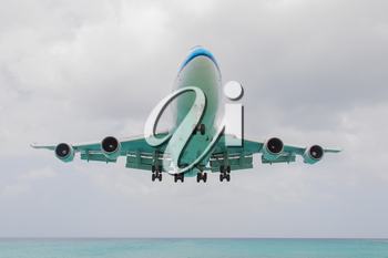 ST MARTIN, ANTILLES - JULY 19, 2013: Boeing 747 aircraft in is landing at Princess Juliana International Airport in Netherlands Antilles in July 19, 2013 in St Martin.