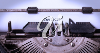 Vintage inscription made by old typewriter, caution