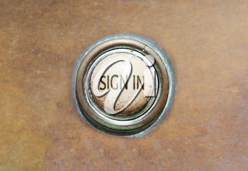 Grunge image of an old button - sign in