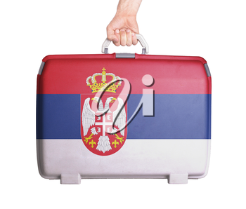 Used plastic suitcase with stains and scratches, printed with flag, Serbia