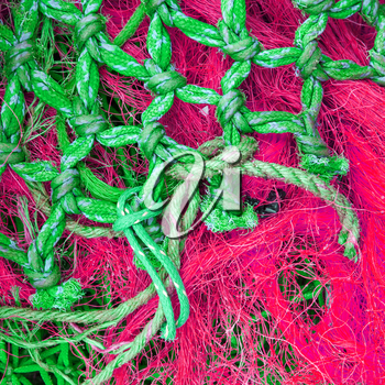 Abstract background with a pile of fishing nets ready to be cast overboard for a new days fishing