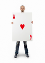 Businessman with large playing card - Ace of hearts